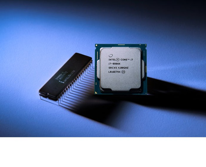 Intel's new Core i7-8086K chip next to Intel's original 8086 processor.