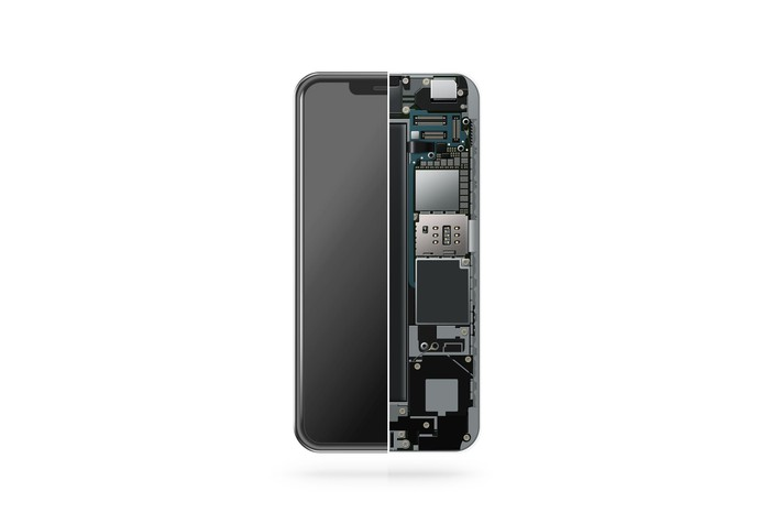The back of a smartphone with half of the internal components showing