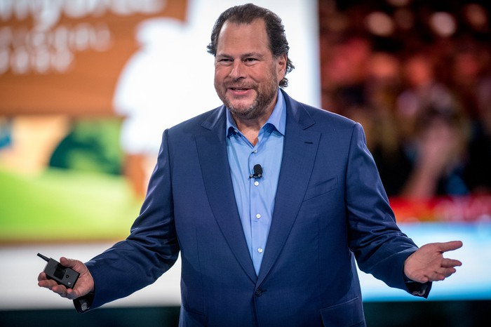 Salesforce Chairman and CEO Marc Benioff of stage giving a presentation.