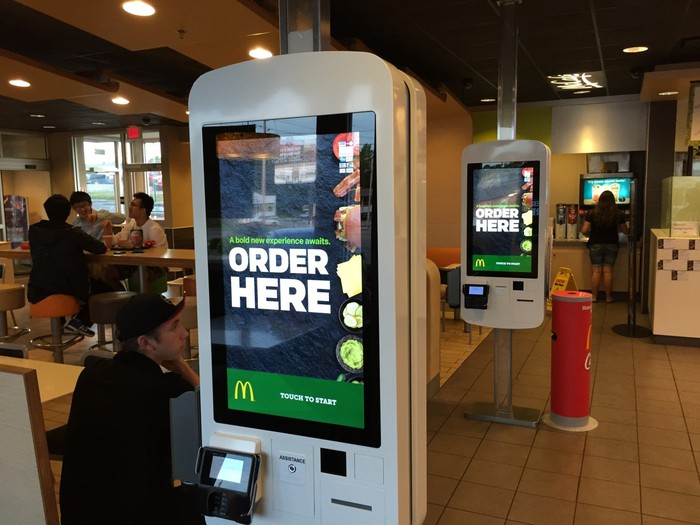 McDonald's self-serve kiosks in a restaurant