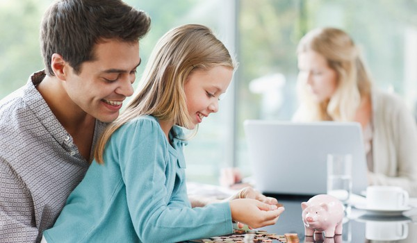 Getty Father Watches Daughter Count Coins