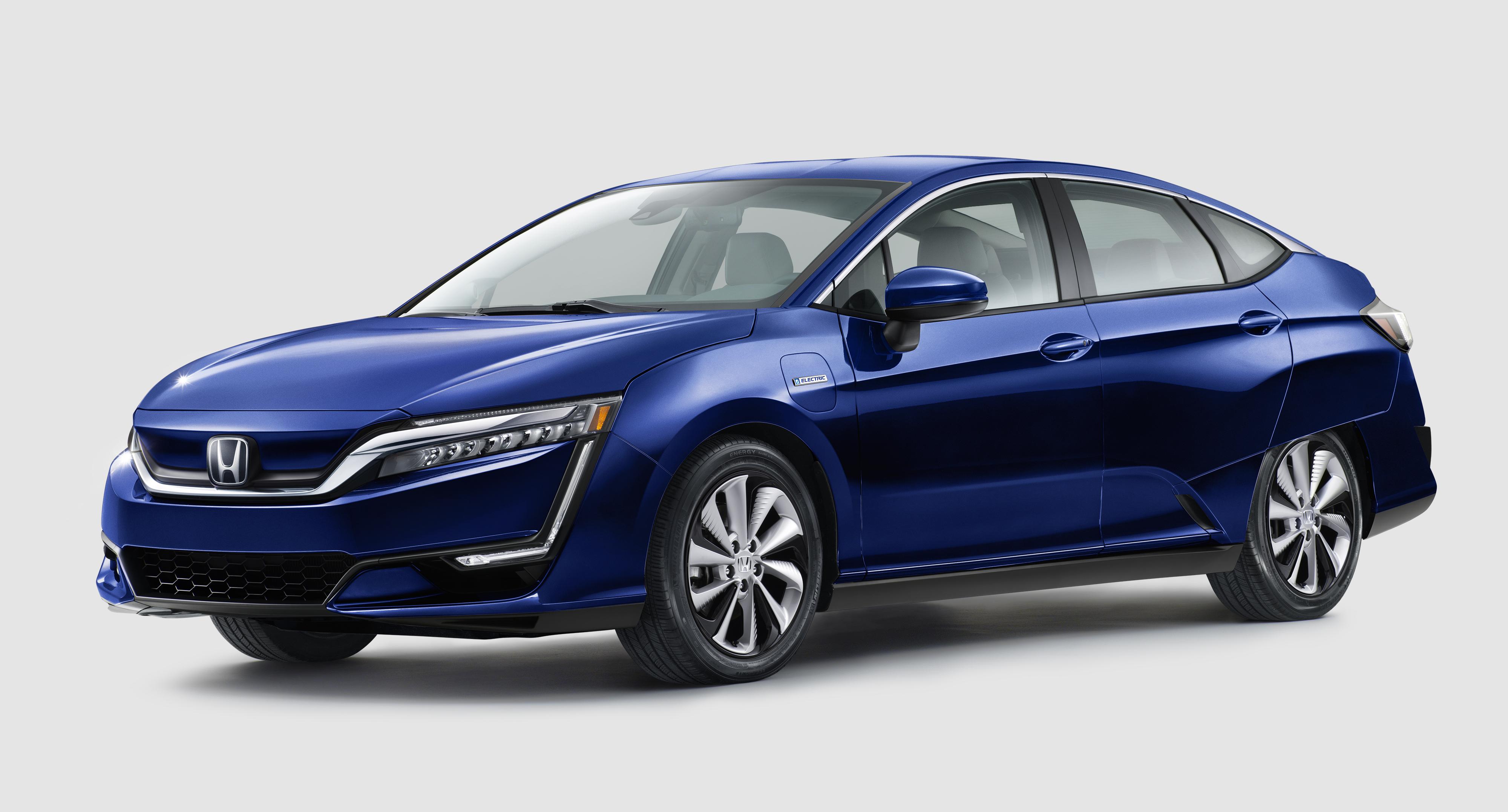 A blue Honda Clarity Electric, a midsize sedan.
