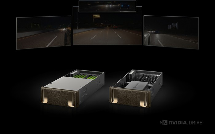NVIDIA's DRIVE self-driving car platform is on display with four monitors showing different views of the road.