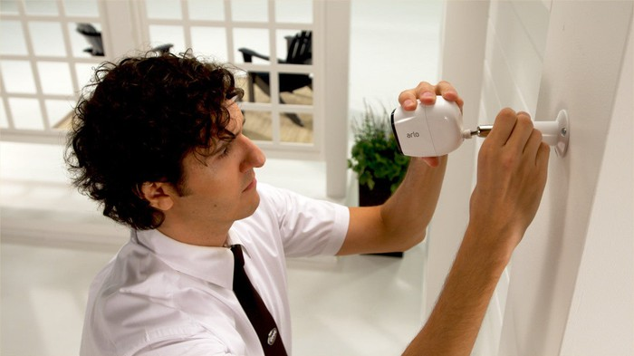 Geek Squad technician installing security camera