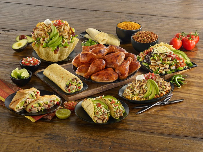 Assorted items from El Pollo Loco's core menu on wooden table.
