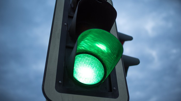 Green light on a traffic light.