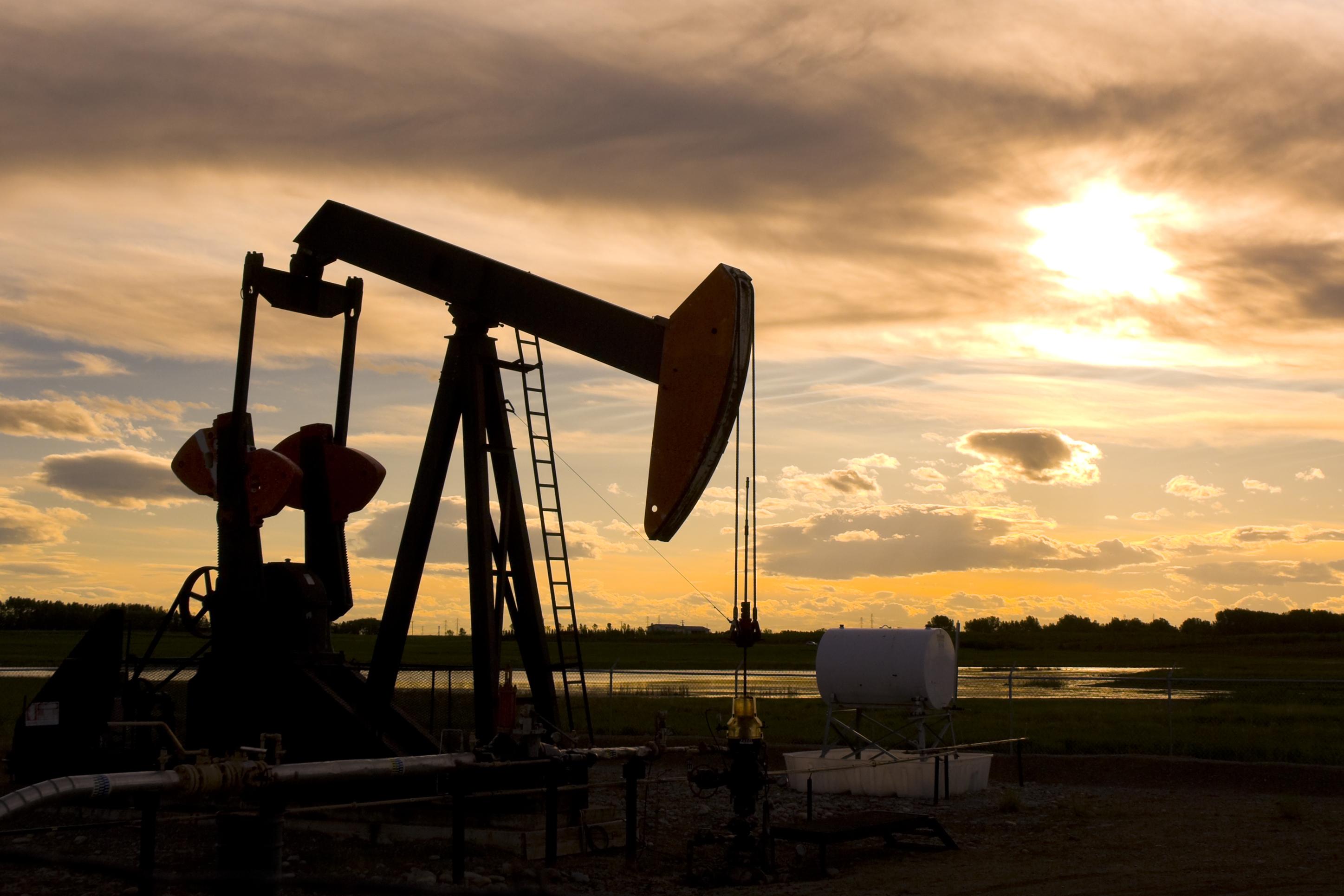 Oil pumpjack against setting sun