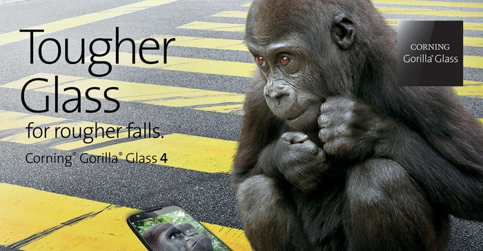A Gorilla Glass advertisement showing a gorilla sitting in a crosswalk looking at a smartphone on the ground