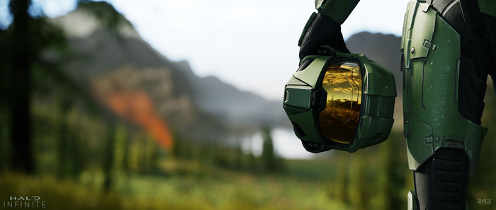 Master Chief from Microsoft's Halo series holding his helmet and looking at a mountain landscape.