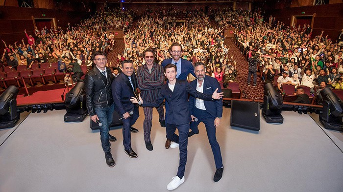 Avengers: Infinity War cast posing for a photo in front of an audience at the Shanghai Disney Resort.