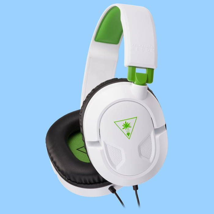 A White Turtle Beach Recon 50x Headset With Green Accents