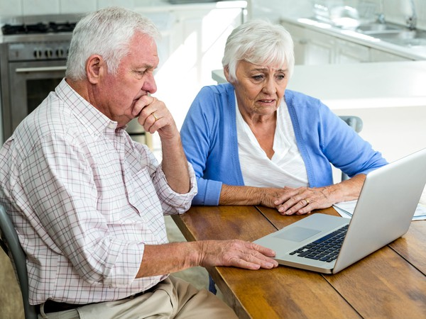 worried seniors at laptop_GettyImages-668025836