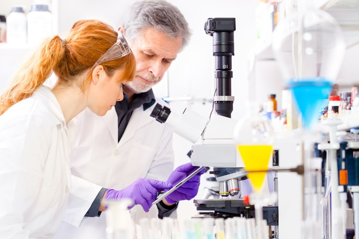 Male and female scientists in lab