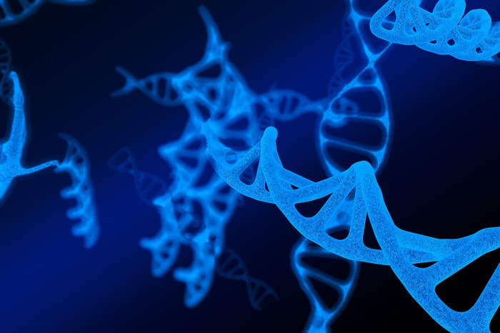 3-D image of DNA molecules floating in a deep blue background.