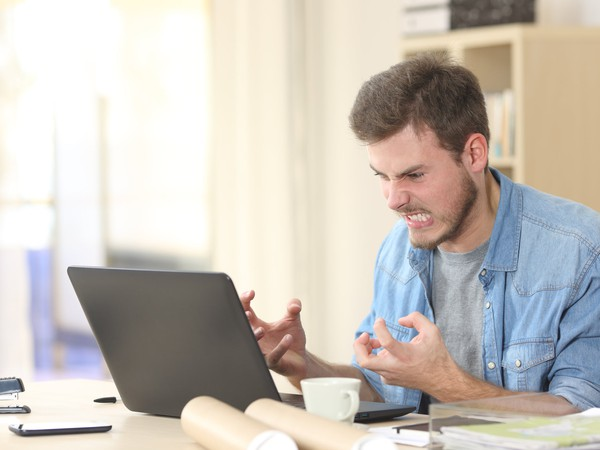 angry man at laptop_GettyImages-536669536