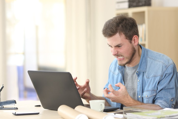Man at laptop looking angry
