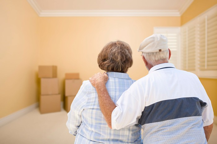 Senior couple looking at moving boxes