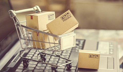 Grocery Cart on laptop filled with boxes GettyImages-675645602