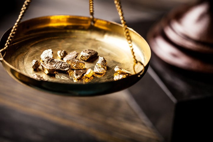 Gold pieces in an old-fashioned scale.
