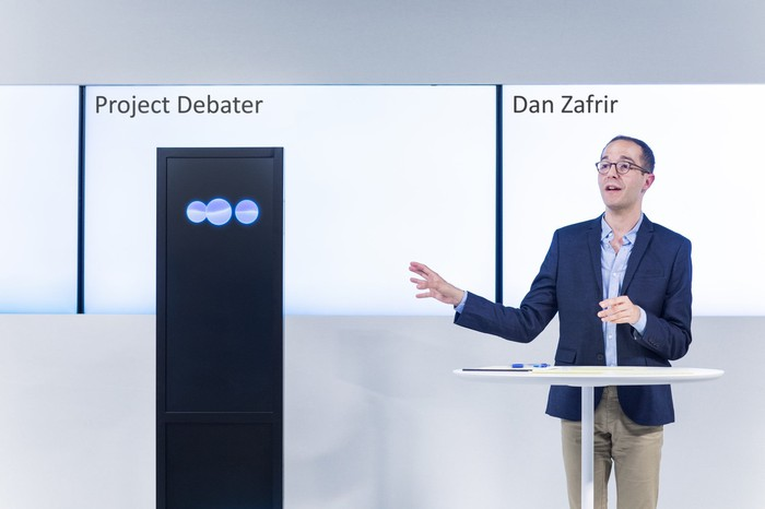 IBM's Project Debater and debate expert Dan Zafrir.
