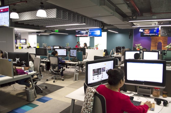 Editors working in a newsroom