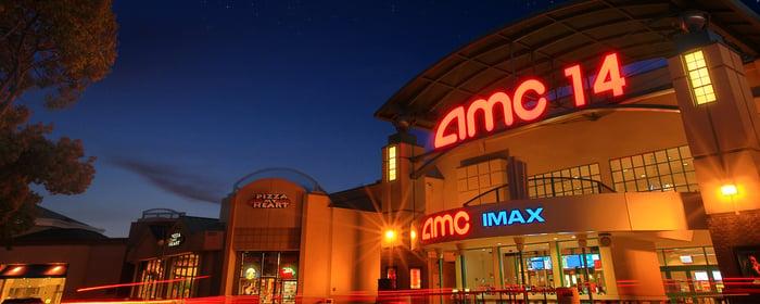 AMC Saratoga 14 exterior shot at night.
