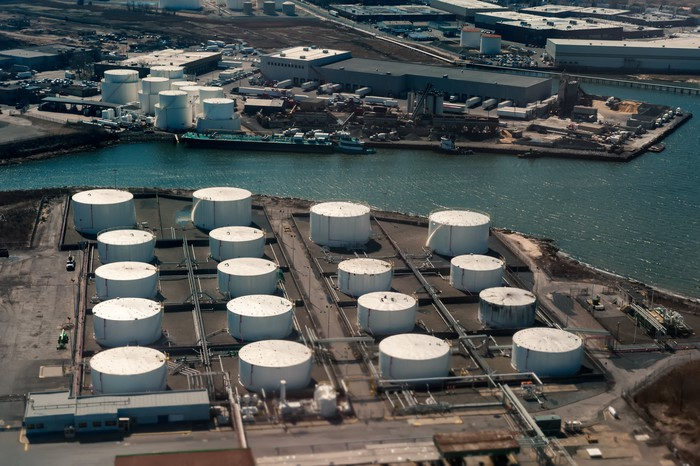 Aerial View of oil tanker and storage tanks.
