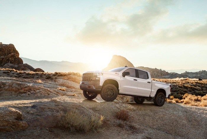 The all-new 2019 Silverado Custom Trailboss parked off road.