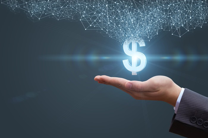 Image of an open hand with a dollar sign radiating outwards.