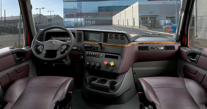 Spacious interior of International brand truck cab.