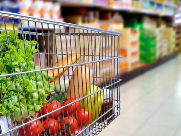 Cart in supermarket blurred from side