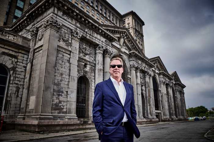 Bill Ford standing in front of Michigan Central Station