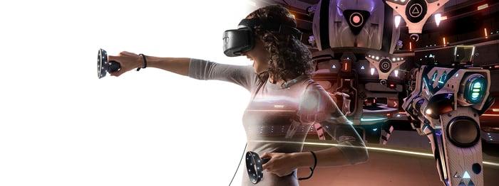 A woman uses a Windows Mixed Reality headset.