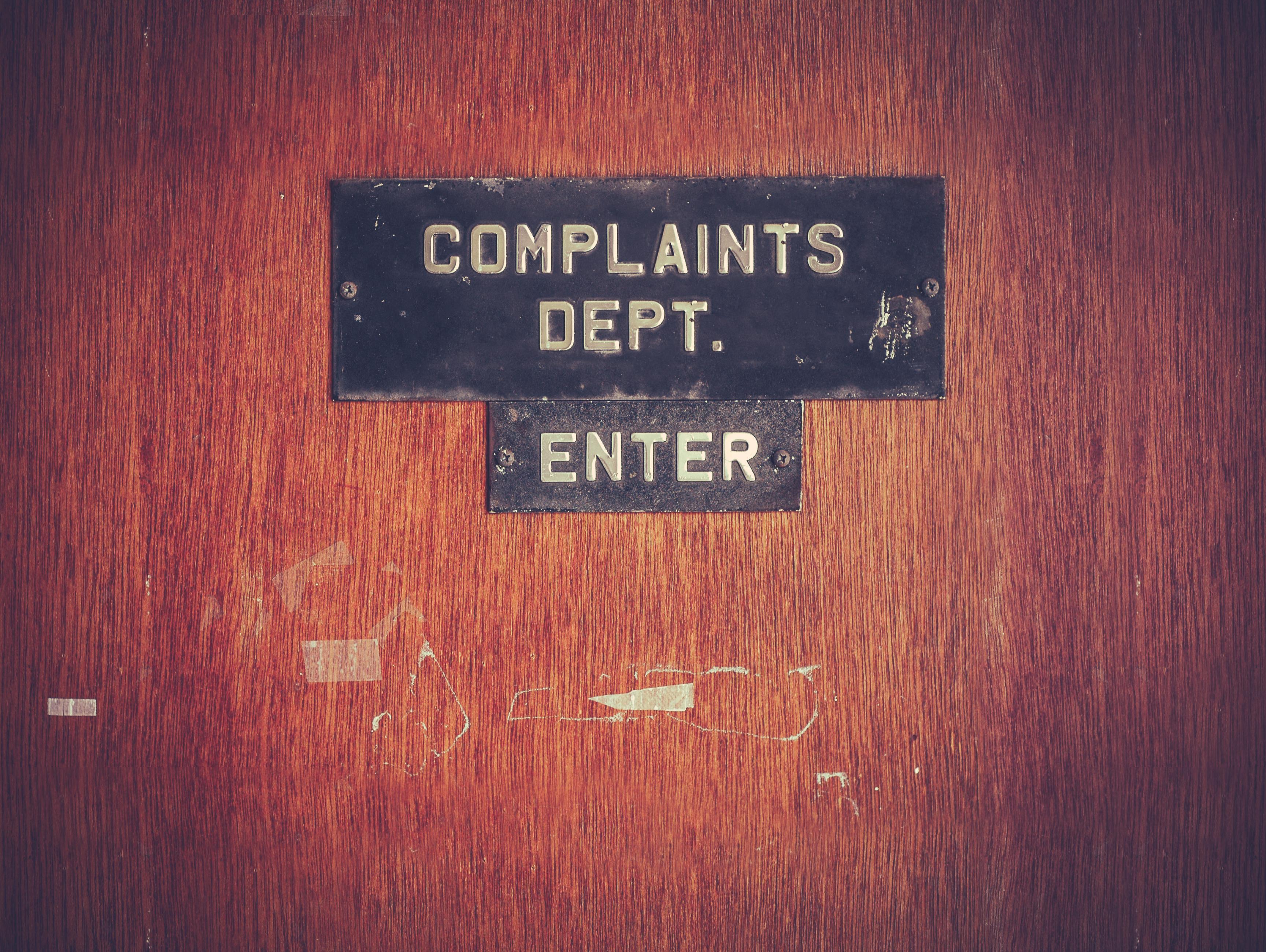 Door with complaints dept. lettering on it.