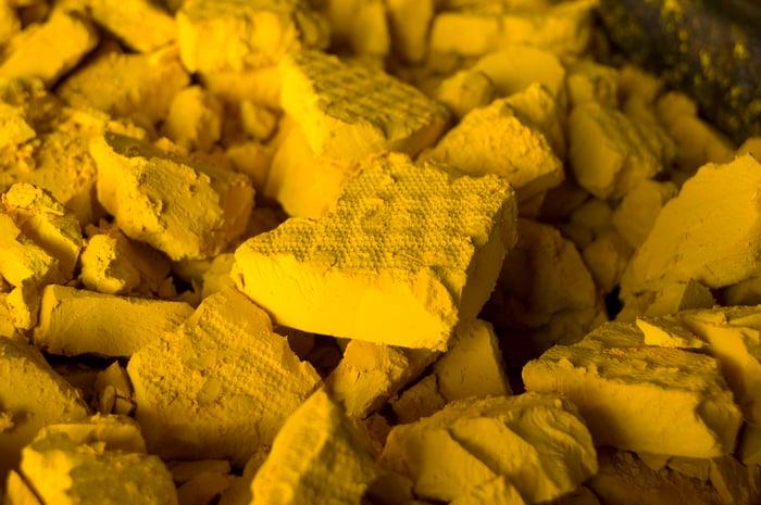 A heap of yellow uranium cakes.