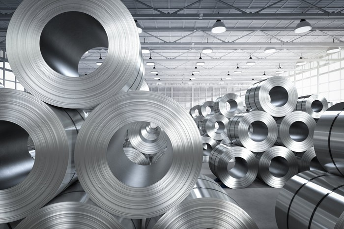 Rolls of steel sheet in a factory.