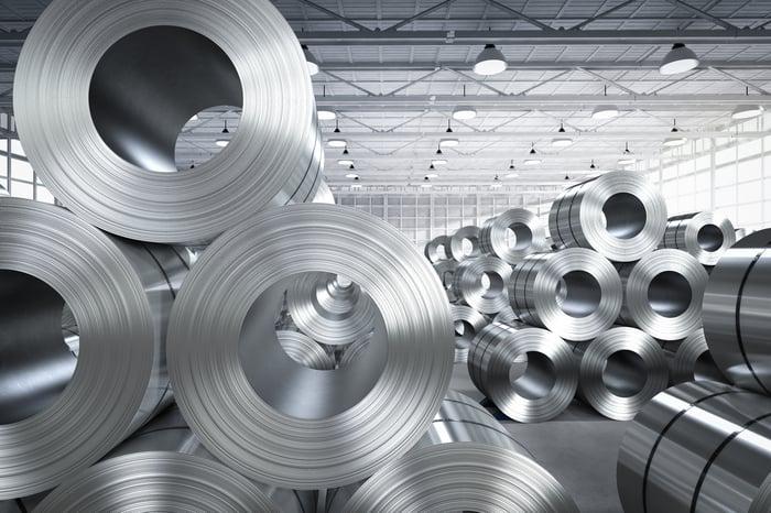 Rolls of steel sheet in a factory.