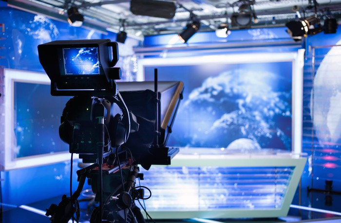 Interior of a television station studio desk and camera.