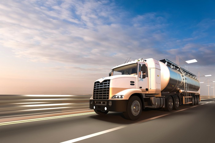 A natural gas truck driving on the highway.
