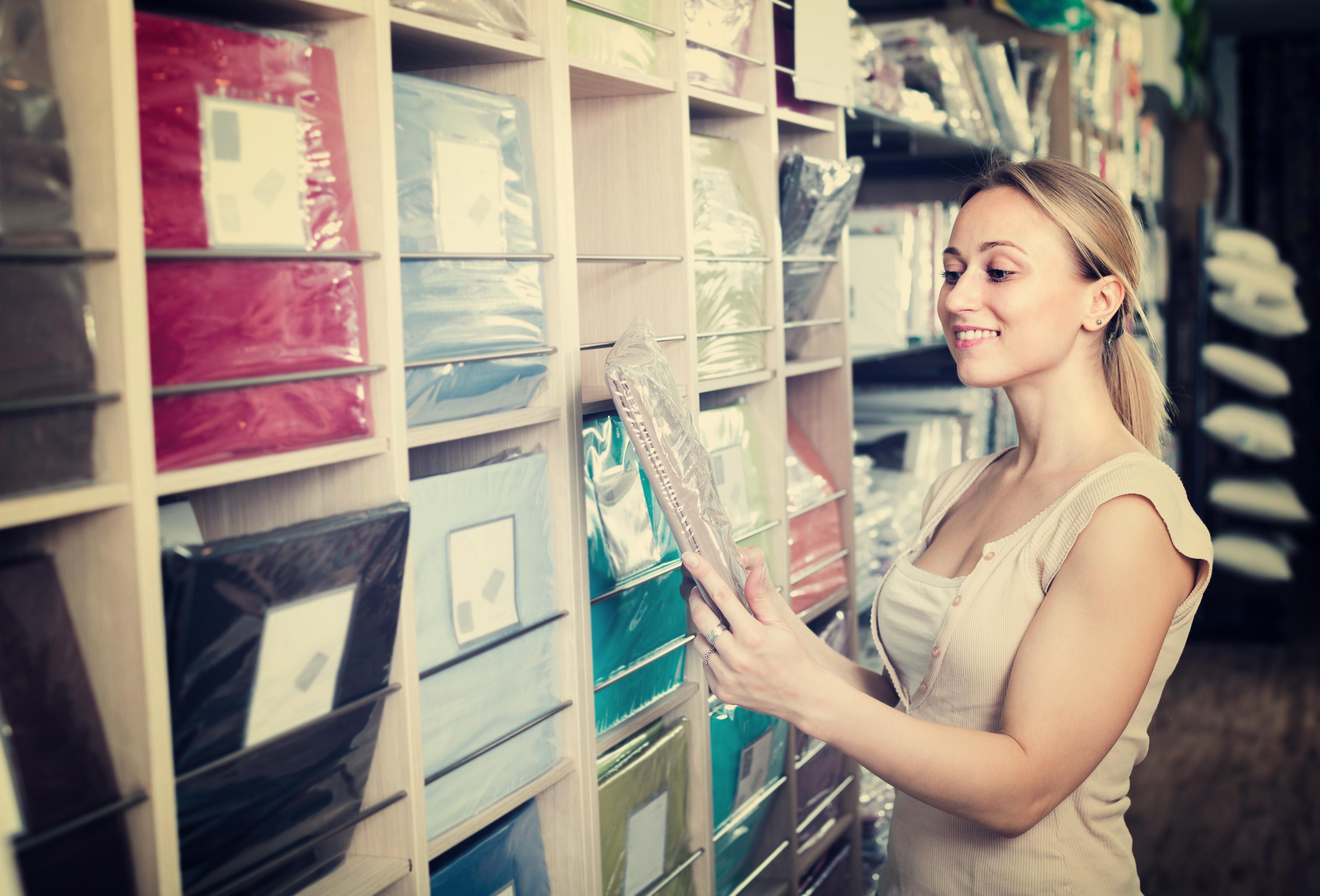 Woman looking at bedding display
