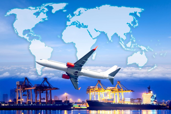 Air freighter superimposed against world map background