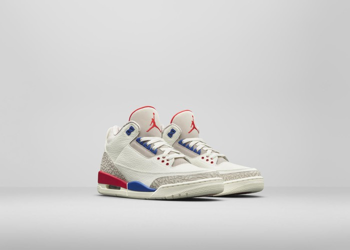 White Nike Air Jordan sneakers with blue and red accents