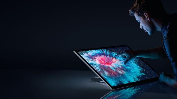 A man using Microsoft's Surface Studio.