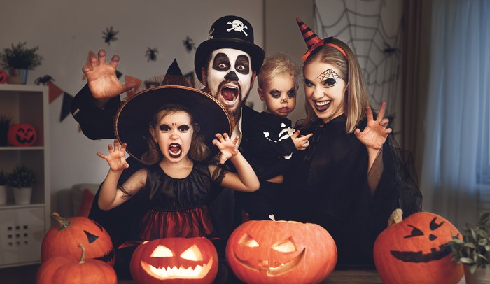 Family in Halloween costumes