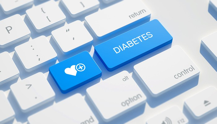A blue key on a keyboard with the word DIABETES printed on it