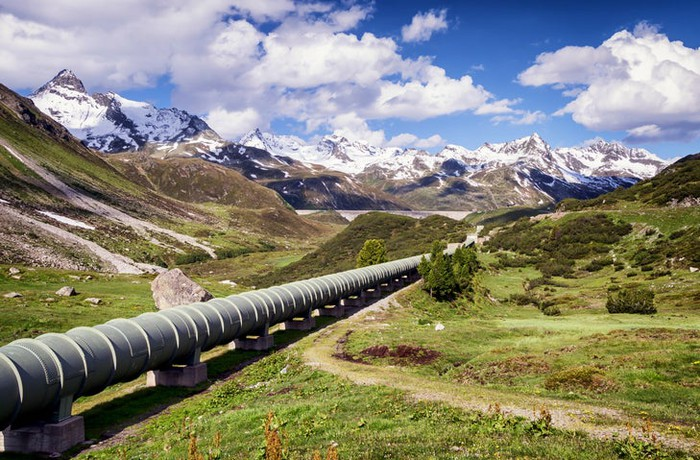 A pipeline traveling through a mountain valley.