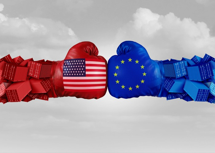 Boxing gloves representing the U.S. and EU clashing