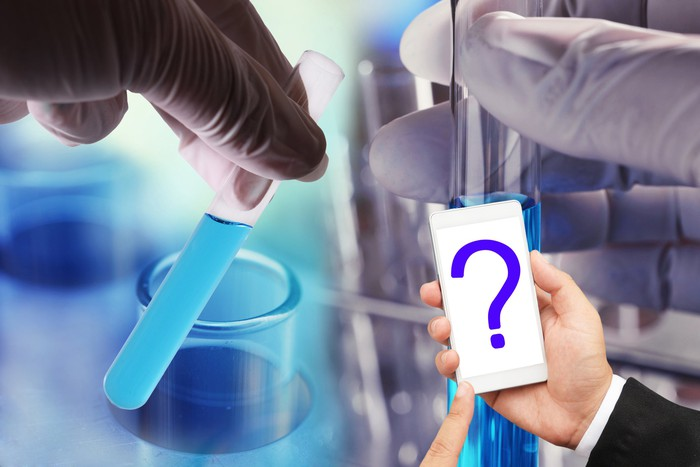 Gloved hands holding test tubes juxtaposed with a businessman's hand holding a white smartphone displaying a question mark