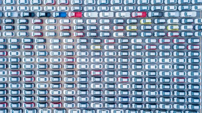 A bird's eye view of a car lot.