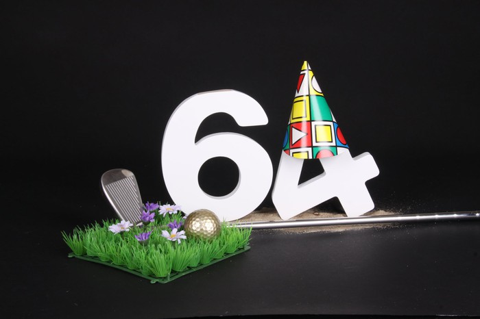 the number 64 in 3D next to a golf club and ball, with a party hat on the number 4